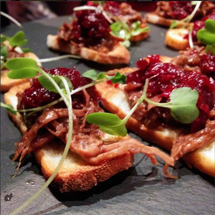 Slow roast lamb shoulder, beetroot chutney on crisp bread
