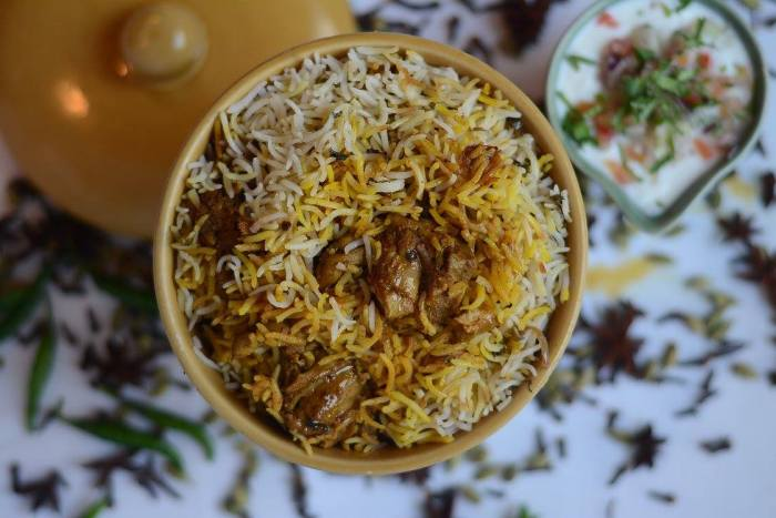 Murgh Dum Biryani - Basmati rice cooked with boneless chicken and flavored with spices and herbs