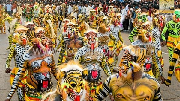 Onam Pulikali - Men dressed as lions, tigers and leopards, parade through the city in large numbers. The Pulikali also marks the end of traditional Onam celebrations.